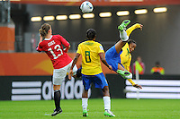 Ester (r) and Formiga (C) of team Brazil and Madeleine Giske of team Norway during the FIFA Women's World Cup at the FIFA Stadium in Wolfsburg, Germany on July 3rd, 2011.