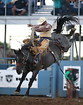 Chad Ferley competes in the saddle bronc event at the Reno Rodeo in Reno, Nev., on Thursday, June 27, 2013.<br /> Photo by Cathleen Allison