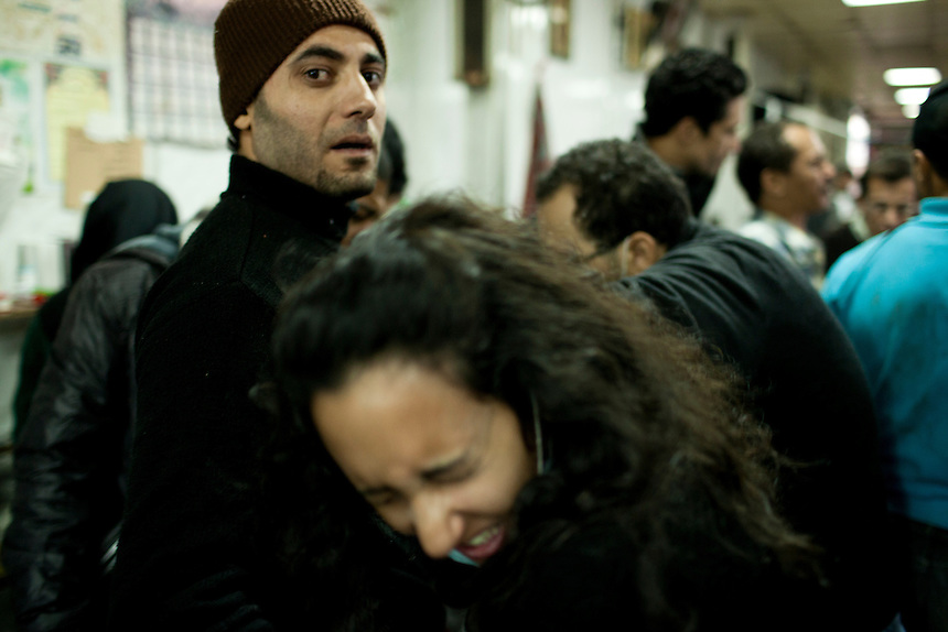A young Egyptian woman winces in pain as she recieves treatment for an injury to her hand in a makeshift triage unit during clashes near Cairo's Tahrir Square, November 20, 2011. Photo: Ed Giles.