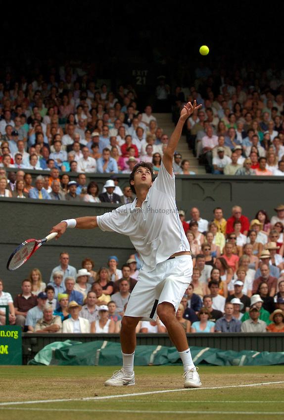 Photo: Richard Lane..Wimbledon Championships. 05/07/2006. .Mario Ancic of Croatia serves.