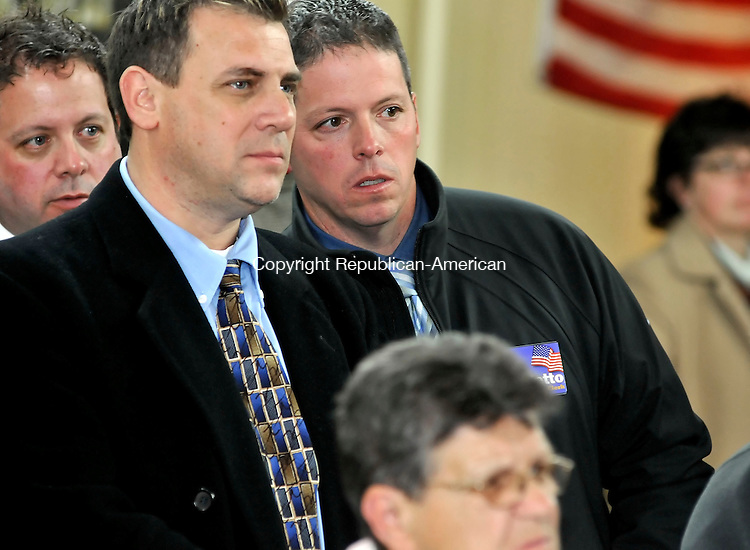 TORRINGTON, CT-03 NOVEMBER 2009-110309JS08-Torrington city clerk candidates Paul F. Samele Jr., left and Douglas J. Benedetto, right, look on as votes are tallied Tuesday at the Democratic headquarters in Torrington. <br /> Jim Shannon Republican-American