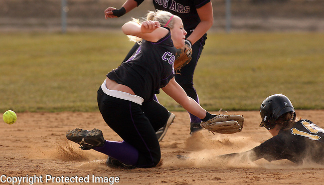 SIOUX FALLS, SD - APRIL 7 --  The ball gets past Tarra Gacke #11 of the University of Sioux Falls as Becca Hengeveld #14 of Dordt College steals second base during their game Monday afternoon at Sherman Park in Sioux Falls. (Photo by Dick Carlson/Inertia)