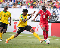 PHILADELPHIA, PA - JUNE 30: Abdiel Arroyo #18 and Elvis Powell #5 go for the ball during a game between Panama and Jamaica at Lincoln Financial Field on June 30, 2019 in Philadelphia, Pennsylvania.