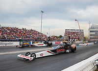 Sep 28, 2019; Madison, IL, USA; NHRA top fuel driver Billy Torrence (near) races alongside son Steve Torrence during qualifying for the Midwest Nationals at World Wide Technology Raceway. Mandatory Credit: Mark J. Rebilas-USA TODAY Sports