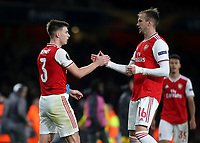 Kieran Tierney and Rob Holding of Arsenal at the final whistle during Arsenal vs Standard Liege, UEFA Europa League Football at the Emirates Stadium on 3rd October 2019
