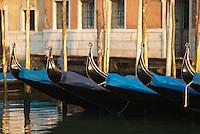 The gondola has been a part of Venetian life since the 11th century. It is a traditional, flat-bottomed rowing boat perfectly adapted to the narrow canals of Venice. In 1592 an official decree forever called for all gondolas to be painted black to prevent an ostentatious competition to demonstrate individual wealth.