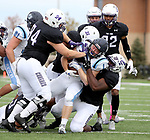 SIOUX FALLS, SD - OCTOBER 27: Tyler Heredia #94 and Harvey Enalls #31, among others, from the University of Sioux Falls gang tackle Jon Deprey #1 from Upper Iowa during their game Saturday at Bob Young Field in Sioux Falls. (Photo by Dave Eggen/Inertia)