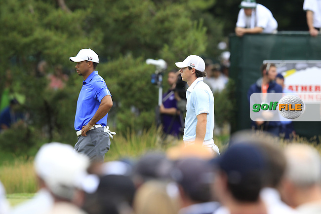 Rory McIlroy (NIR) and Tiger Woods (USA) on the 4th green during Thursday's Round 1 of the 113th U.S.Open National Championship held at Merion Golf Club, Ardmore, Philadelphia, Pennsylvania. <br /> 13th June 2013<br /> (Picture: Eoin Clarke www.golffile.ie)
