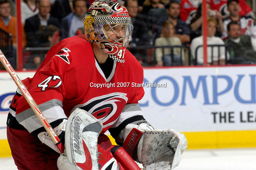 Carolina Hurricanes' goalie John Grahame watches the action against the New Jersey Devils Thursday, March 15, 2007 at the RBC Center in Raleigh, NC. New Jersey won 3-2.