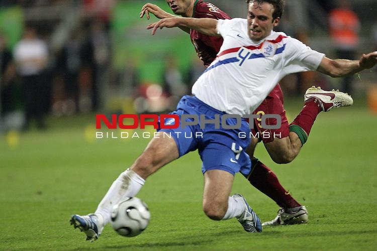 FIFA WM 2006 -  Round of Sixteen - / Viertelfinale <br /> Play     #52 (25-Jun) - Portugal vs Niederlande ( Holland ) <br /> <br /> <br /> Zweikampf Joris Mathisen gegen Pauletta<br /> <br /> Foto &copy; nordphoto