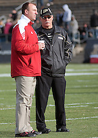 Wisconsin head coach Bret Bielema (left) and Purdue head coach Danny Hope chat before the game. The Wisconsin Badgers defeated the Purdue Boilermakers 34-13 at Ross-Ade Stadium, West Lafayette, Indiana on November 6, 2010.