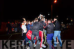 Pobalscoil Chorca Dhuibhne players celebrating the winning of the Hogan Cup in Dingle on Saturday night.