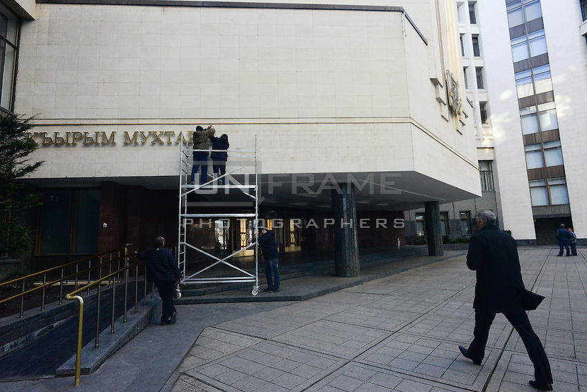 "After 2 hours since the signing of the Russian-Crimean treaty the letters on the entrance of the Crimean parliament ""Parliament of autonomous republic of Crimea"" are being removed and coat-of-arms is being replaced."