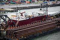 aerial photograph Great Lakes Dredge and Dock Company barge loaded with pipes underway at Port of Oakland, California