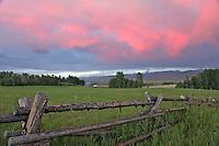 Teton Valley Sunset, buckrail fence, farm, Victor Idaho
