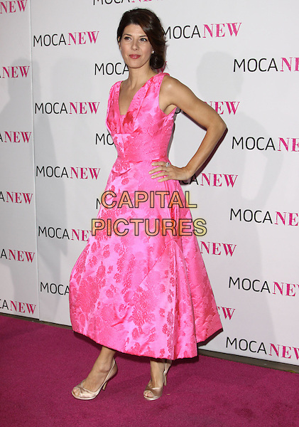 MARISA TOMEI .At MOCA's 30th Anniversary Gala held at MOCA, Los Angeles, California, USA, 14th November 2009. .full length pink sleeveless dress floral print silk satin open toe beige shoes embroidered gold hand on hip .CAP/ADM/KB.©Kevan Brooks/AdMedia/Capital Pictures.