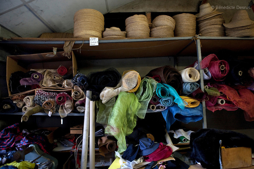 9 december 2009 - Coustilleres' hat factory, Septfonds, France - supplies and materials. .Septfonds is the heart of French straw hat making, due to its very ancient hatter tradition. The hat making industry had its commercial peak in the late 19th century..Coustillères is a family owned hat making factory that has been making straw hats in Septfonds for nearly 100 years. They make hats from straw, felt, and cloth as well as caps. The current owner is Jean-Claude Coustilleres. He is one of the last hat makers of the region..The straw hat making process is very labor intensive and numerous hands are involved. Nearly all of the equipment is over 100 years old, they use the original presses and tools including aluminium molds and sewing machines and dye their own straw continuing the traditional methods of manufacturing. The hat blocking and shaping, straw braids construction and dyeing are all done by hand..The company works on behalf of fashion houses and makes a variety of regional and historical hats. It produces 2 collections a year distributed by a network of salespeople and through a catalog to clients around the world. Photo credit: Benedicte Desrus