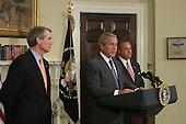 Washington, D.C. - June 19, 2007 -- United States President George W. Bush, center, announces former US Representative Jim Nussle (Republican of Iowa), right, as director of the Office of Management and Budget (OMB) to succeed Rob Portman, left,, Tuesday, June 19, 2007 at The White House in Washington DC.<br /> Credit: Chris Kleponis - Pool via CN