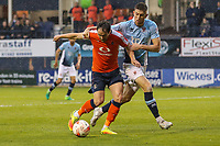 Danny Hylton of Luton Town and Will Aimson of Blackpool tussle inside the Blackpool penalty box during the Sky Bet League 2 Play Off Semi Final 2 leg match between Luton Town and Blackpool at Kenilworth Road, Luton, England on 18 May 2017. Photo by David Horn.
