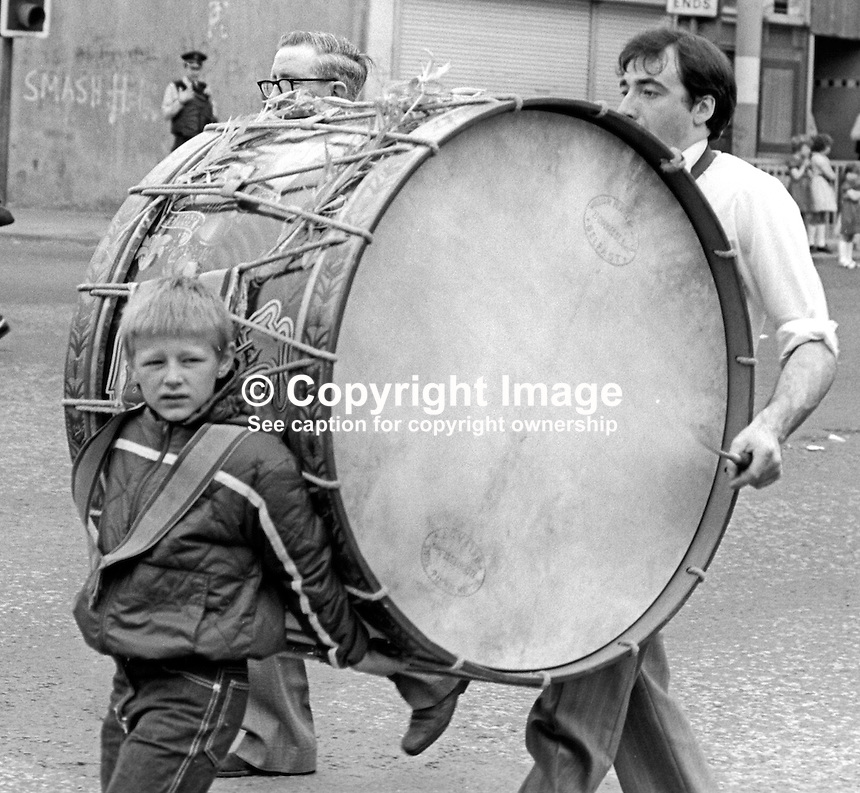 Lambeg drummer taking part in the July 1976 Twelfth parade in Belfast, N Ireland.  197607120331c<br />