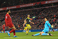 1st February 2020; Anfield, Liverpool, Merseyside, England; English Premier League Football, Liverpool versus Southampton; Mohammed Salah of Liverpool chips the ball over Alex McCarthy of Southampton to score his side's third goal after 72 minutes