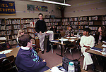 San Francisco CA Elementary school teacher presenting an issue to colleagues at after school teachers' meeting in school library