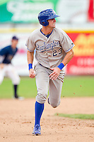 Bubba Starling (23) of the Burlington Royals hustles towards third base against the Princeton Rays at Hunnicutt Field on July 15, 2012 in Princeton, West Virginia.  The Royals defeated the Rays 2-0 in game one of a double header.  (Brian Westerholt/Four Seam Images)