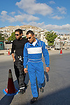 George Saadeh, 2009 Palestine speed test champion, takes part in the second race of the 2010 season in the centre of Nablus on 21/05/2010. George & another competitor walk the route of the track, which is marked by cones along a central strip of road in Nablus.
