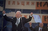 Moscow, Russia, June 1996..President Boris Yeltsin, accompanied by Mayor Yuri Luzhkov & Prime Minister Viktor Chernomyrdin, addresses election rally outside the Kremlin.
