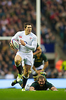 Alex Goode of England launches an attack after evading the tackle of Jannie du Plessis of South Africa during the QBE Autumn International match between England and South Africa at Twickenham on Saturday 24 November 2012 (Photo by Rob Munro)
