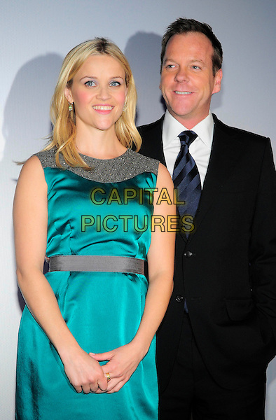"REESE WITHERSPOON & KIEFER SUTHERLAND.Premiere of ""Monsters vs. Aliens"", UCI Colosseum Kino, Berlin, Germany..March 9th, 2009.half length blue green turquoise silk satin sleeveless dress grey gray black suit jacket .CAP/PPG/NK.©Norbert Kesten/People Picture/Capital Pictures"