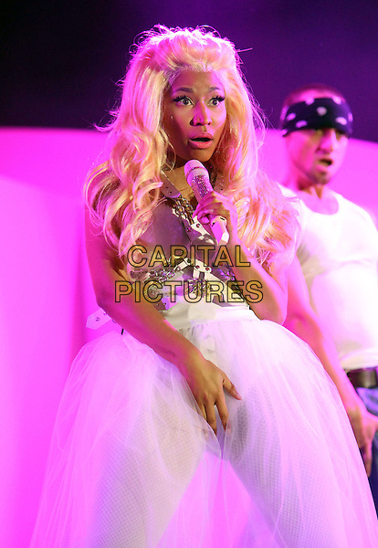Nicki Minaj.102.7 KIIS FM's Wango Tango Show Held at Home Depot Center, Carson, California, USA, 12th May April 2012..music live concert gig on stage performing half length white dress microphone blonde hair wig tulle skirt hand grabbing on crotch funny face .CAP/ADM/FS.©Faye Sadou/AdMedia/Capital Pictures.