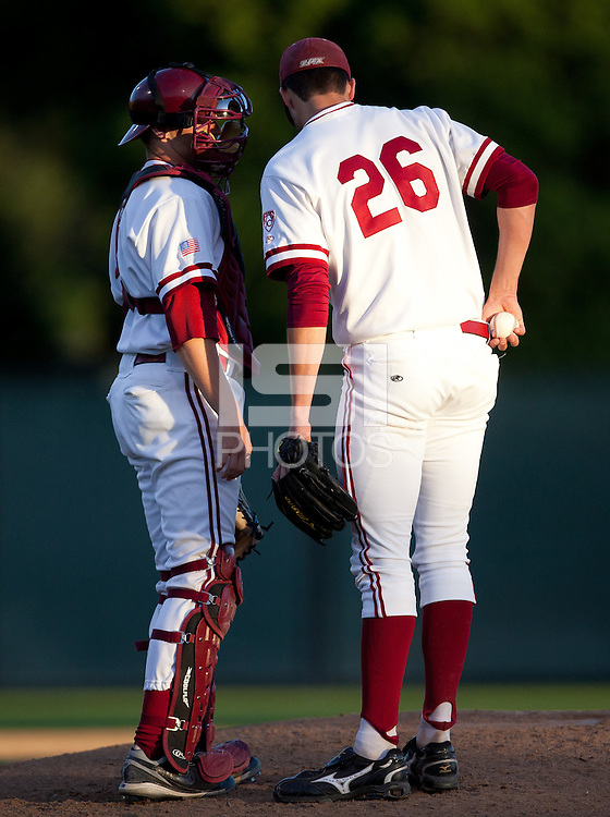 STANFORD, CA - April 21, 2011: Zach Jones of Stanford baseball talks to Mark Appel at the mound during Stanford's game against UCLA at Sunken Diamond. Stanford won 7-4.