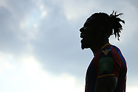 The silhouette of Wilfred Zaha of Crystal Palace laughing upon the final whistle during Crystal Palace vs Brighton & Hove Albion, Premier League Football at Selhurst Park on 14th April 2018