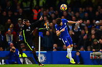 Jose Izquierdo of Brighton leaves a high foot in against Cesc Fabregas of Chelsea during the EPL - Premier League match between Chelsea and Brighton and Hove Albion at Stamford Bridge, London, England on 26 December 2017. Photo by PRiME Media Images.