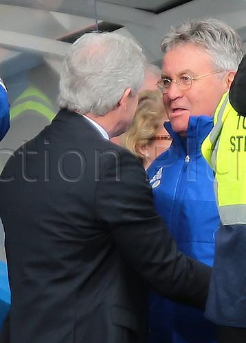 05.03.2016. Stamford Bridge, London, England. Barclays Premier League. Chelsea versus Stoke City. Chelsea Manager Guus Hiddink greets Stoke Manager Mark Hughes before kick off