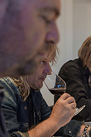Switzerland. Canton Ticino. Cagiallo. Merlot wine testing for the new Magnificents' 17. Sacha Pelossi (L), the Gotthard musicians Leo Leoni (C), and Nic Maeder (R). The Swiss rock band Gotthard is associated with winemakers Valentina Andrei (Merlot Ivresse from Valais) and Sacha Pelossi (Merlot from Ticino) to create the new assemblage (50-50 from both winemakers) for a unique vintage bottle: Magnificents' 17. Gotthard is a Swiss hard rock band founded in Lugano by Steve Lee and Leo Leoni. Their last eleven albums have all reached number 1 in the Swiss album charts, making them one of the most successful Swiss acts ever. With 2 million albums sold, they managed to get multi-platinum awards in different parts of the world. Cagiallo is a village and and is part of the Capriasca municipality. 25.03.2019 © 2019 Didier Ruef