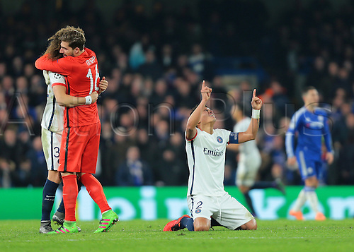 09.03.2016. Stamford Bridge, London, England. Champions League. Chelsea versus Paris Saint Germain. Paris St. Germain Defender Thiago Silva kneels and points to the sky after team mate Zlatan Ibrahimović makes it 2-1 PSG, and PSG Goalkeeper Kevin Trapp celebrates with David Luiz