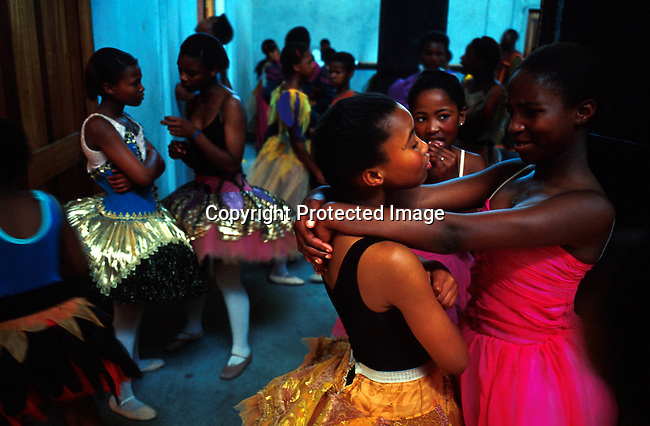 """dipptee00004 .People Teenagers. Ballet dancers in the """"Dance for All """", programme started by the Capetown City Ballet for unpriviliged children in Khayelitsha and Guguletu, poor townships outside Cape Town, South Africa. They're chatting backstage before a performance in Guguletu..©Per-Anders Pettersson/iAfrika Photos"""