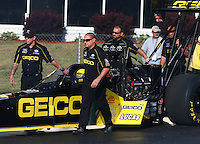 May 16, 2014; Commerce, GA, USA; Crew members with NHRA top fuel dragster driver Richie Crampton during qualifying for the Southern Nationals at Atlanta Dragway. Mandatory Credit: Mark J. Rebilas-USA TODAY Sports