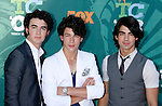 Musicians Kevin Jonas, Nick Jonas, and Joe Jonas of The Jonas Brothers arrive at the 2008 Teen Choice Awards at the Gibson Amphitheater on August 3, 2008 in Universal City, California.