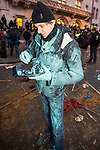 © Joel Goodman - 07973 332324 . 09/12/2010 . London , UK . A paint-splattered man . Students and their supporters clash with police during a demonstration in Parliament Square in London against government cuts to student support , Educational Maintenance Allowance ( EMA ) and rising university tuition fees . Photo credit : Joel Goodman
