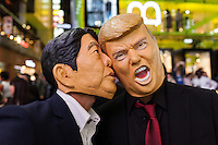 Revellers wearing Donald Trump and Japanese Prime Minister, Shinzo Abe masks during the Halloween celebrations in Shibuya, Tokyo, Japan. Saturday October 29th 2016 Halloween celebration in Japan have grown massively in the last few years. To ensure the safety of the crowds in Shibuya this year, the police closed several roads leading to the famous Hachiko Square, allowing costumed revellers to spread over a larger area.