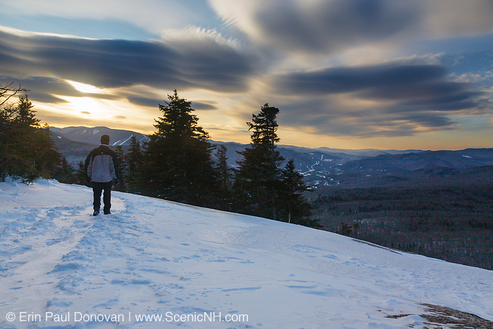 Cloudy sunrise from the summit of Mount Pemigewasset in Lincoln, New Hampshire on a winter day.