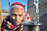 Maya Devi Adhikari, 80, fills a container with water at a community spigot in Makaising, a village in the Gorkha District of Nepal that was hard hit by a devastating 2015 earthquake.