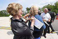 NWA Democrat-Gazette/FLIP PUTTHOFF <br />State Sen. Cecile Bledsoe signs a piece of ribbon with help from State Rep. Rebecca Petty on Wednesday May 10 2017 at the dedication of a section of the Bella Vista bypass. The route is planned to eventually be part of Interstate 49.