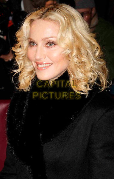 "MADONNA.Premiere of ""Filth & Wisdom, 58th Berlinale Film Festival, Zoo Palace, Berlin, Germany..February 13, 2008.headshot portrait black coat fur trim .CAP/PPG/JH.©Jens Hartmann/People Picture/Capital Pictures"