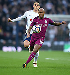 Fabian Delph of Manchester City is challenged by Erik Lamela of Tottenham Hotspurduring the premier league match at the Wembley Stadium, London. Picture date 14th April 2018. Picture credit should read: Robin Parker/Sportimage