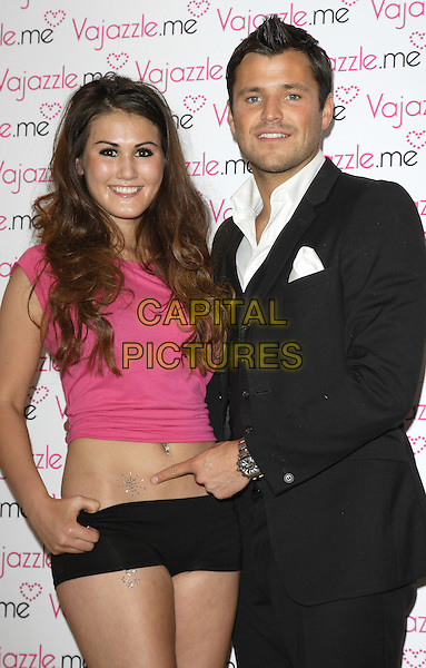 "MARK WRIGHT.launches the official ""The Only Way Is Essex"" (TOWIE) Vajazzle body art crystals at Signor Sassi, Knightsbridge. London, England, UK,.April 13th 2011..half length  black suit white shirt  girl model  tummy midriff stomach finger pointing  waistcoat pink t-shirt hotpants .CAP/ROS.©Steve Ross/Capital Pictures"