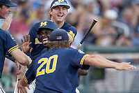 Michigan Wolverines second baseman Ako Thomas (4) celebrates scoring a run in the first inning against the Vanderbilt Commodores during Game 3 of the NCAA College World Series Finals on June 26, 2019 at TD Ameritrade Park in Omaha, Nebraska. Vanderbilt defeated Michigan 8-2 to win the National Championship. (Andrew Woolley/Four Seam Images)